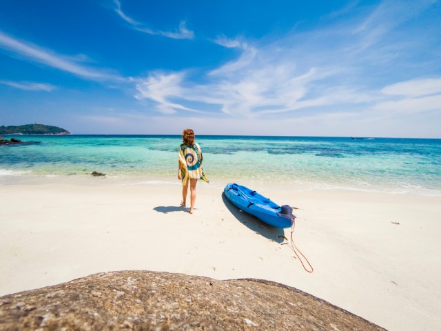 Woman,With,A,Kayak,On,An,Isolated,Beach,In,Andaman