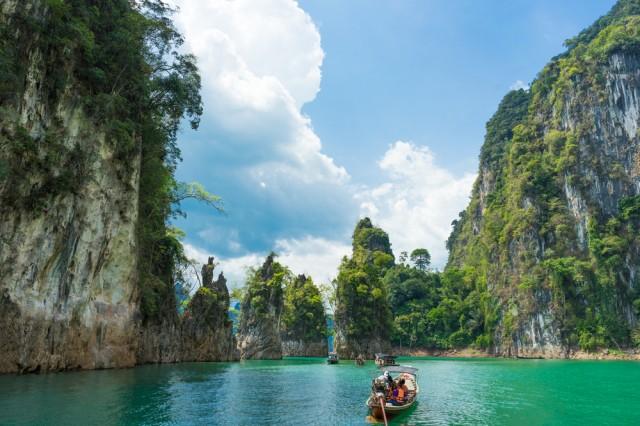 Tourist,Boat,Exploring,Epic,Limestone,Cliffs,In,Huge,Lake,In
